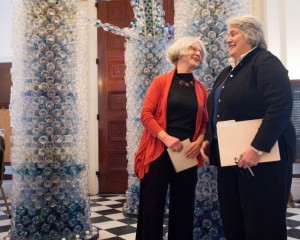 UVM Art Department faculty member Beth Haggart (left) talks with Sen. Ginny Lyon in front of a sculpture Haggart designed and built made from 3,000 empty bottled water bottles. The sculpture was the centerpiece of a press conference held Wed., March 20.  Photo by Andy Duback for UVM