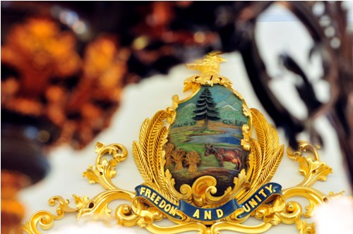 The Vermont coat of arms in all its glory combines rich colors, an abundance of gilt, and a vigorous sweep of movement. Photograph by Jeb Wallace-Brodeur.