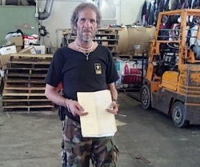 Jeremy Dodge of East Montpelier holds the folder on which Gov. Peter Shumlin sketched out the details on the sale of Dodge's property. Photo by Andrew Stein/VTDigger