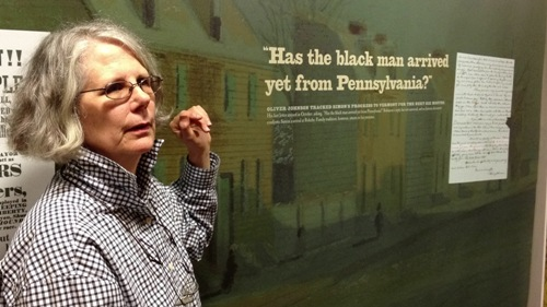 """Jane Williamson, director of the Rokeby Museum in Ferrisburgh, shows off the museum's new exhibit, """"Free and Safe,"""" about the Underground Railroad in Vermont. Before the Civil War, Rokeby was the home Rowland Thomas Robinson and his wife, Rachel, ardent abolitionists who made their sheep farm a safe haven for escaped slaves. Vermont was considered safe for escaped slaves because of its distance from the South and its proximity to Canada. The Robinsons had no need to hide the former slaves, who worked on their farm for pay. Photo by Candace Page"""