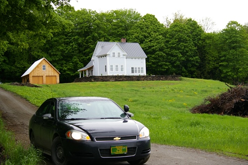 The home of Gov. Peter Shumlin on Foster Road in East Montpelier. A state police vehicle is parked at the end of the driveway on Friday, while the governor was at work. Photo by Andrew Stein/VTDigger