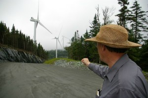 Justin Lindholm, the Rutland County member of the Vermont Fish & Wildlife Board who works for the advocacy group Vermonters for a Clean Environment, points to a spot where he used to see moose before Green Mountain Power built the controversial wind project on the Lowell Mountains ridgeline. Lindholm was on a GMP-hosted tour of the turbine site on July 3, 2013. Photo by Andrew Stein/VTDigger
