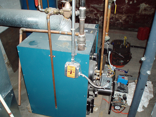 An oil-fired home heating furnace. Creative Commons photo