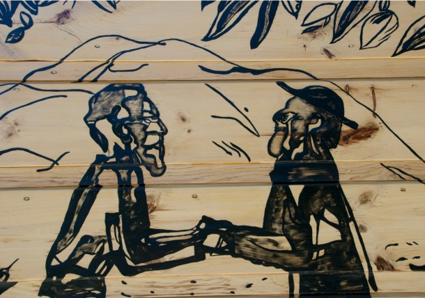 A closeup of Andre Girard's mural depicting Father Damien meeting Brother Joseph Dutton on Molokai, the island leper colony. The mural was painted on the exterior of the Blessed Sacrament Church in Stowe in the late 1940s. Photo by Dirk Van Susteren