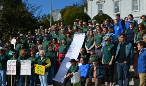 """Vermont State Colleges staff, Vermont State Employees Association members, and other union members convened on the Statehouse steps Monday, Sept. 16, 2013, to call for """"livable wages"""" for all VSC employees. Photo by Alicia Freese/VTDigger"""