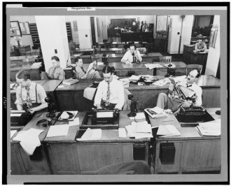 The good old days of American journalism? Newsroom of the New York Times, 1942. Reporters and rewrite men writing stories, and waiting to be sent out. Library of Congress photo