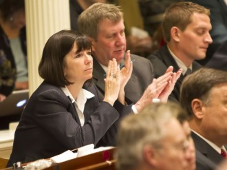 Rep. Patti Komline, R-Dorset, claps during Gov. Peter Shumlin's 2014 budget address. Photo by Roger Crowley