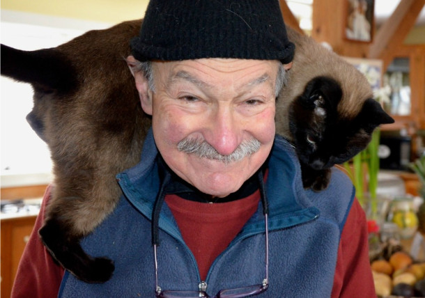 Ed Koren wears a feline neck warmer in his old vlllage house in Brookfield, where he has spent decades illustrating and producing cartoons for the pages of the New Yorker. Koren has been named Vermont's second Cartoonist Laureate. Photo by Andrew Nemethy