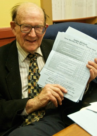"Sen. William Doyle holding up a copy of this year's ""Doyle Poll,"" a survey he has been presenting to voters since 1969. Photo by Dirk Van Susteren"