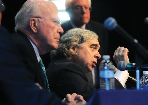 U.S. Energy Secretary Ernest Moniz, seated between Sens. Patrick Leahy, left, and Bernie Sanders, answers a question about the use of natural gas during the Sustainable Energy Summit held at Middlebury College on Friday, May 16, 2014. Independent photo/Trent Campbell