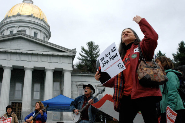 Demonstrators rallied at the Statehouse on Thursday for May Day. Photo by John Herrick/VTDigger