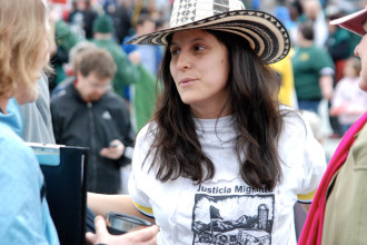 Natalia Fajardo, an organizer with Migrant Justice, attends a May Day rally in Montpelier. Photo by John Herrick/VTDigger