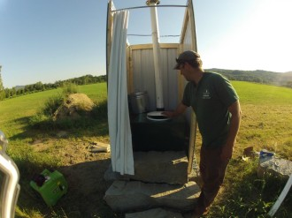 Walter Opuszynski checks out a NFCT-designed removable composting toilet installed at a campsite on the Connecticut River. Furnished photo.