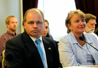Lawrence Miller, chief of health care reform testified before the Joint Fiscal Committee on July 24, 2014, with Stephanie Beck, the person responsible for the overhaul of Human Services' IT systems. Photo by Hilary Niles/VTDigger