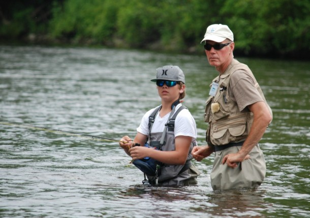 Don Coffey, a staff member for Vermont Trout Unlimited, works last year with a boy during the trout camp for teens that is held every year in June at Quimby Country. Photo courtesy of The Mad Dog Chapter of Trout Unlimited.