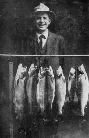 A man shows off his catch of trout and salmon in this photo from Cold Springs Camps circa the 1920s. Photo courtesy of Quimby Country archive.