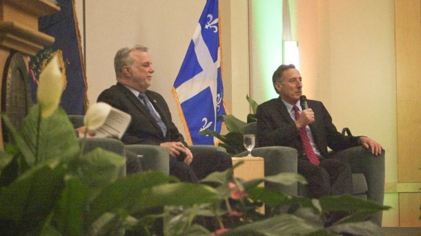 Quebec Premier Philippe Couillard and Gov. Peter Shumlin discuss the relationship between Vermont and Quebec during a dinner ceremony at a energy conference in Burlington on Monday. Photo by John Herrick/VTDigger