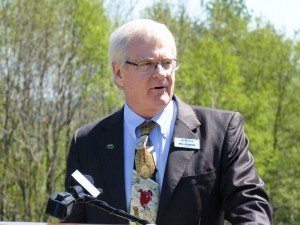 Jay Peak's Bill Stenger speaks at a groundbreaking ceremony for a proposed AnC Bio facility in Newport. Photo by Anne Galloway/VTDigger