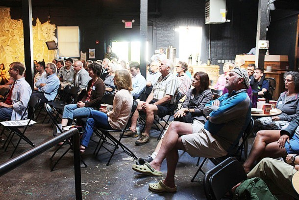 Audience members listen at ArtsRiot on June 17, as city planners present PlanBTV South End. (Photo by Jess Wisloski)
