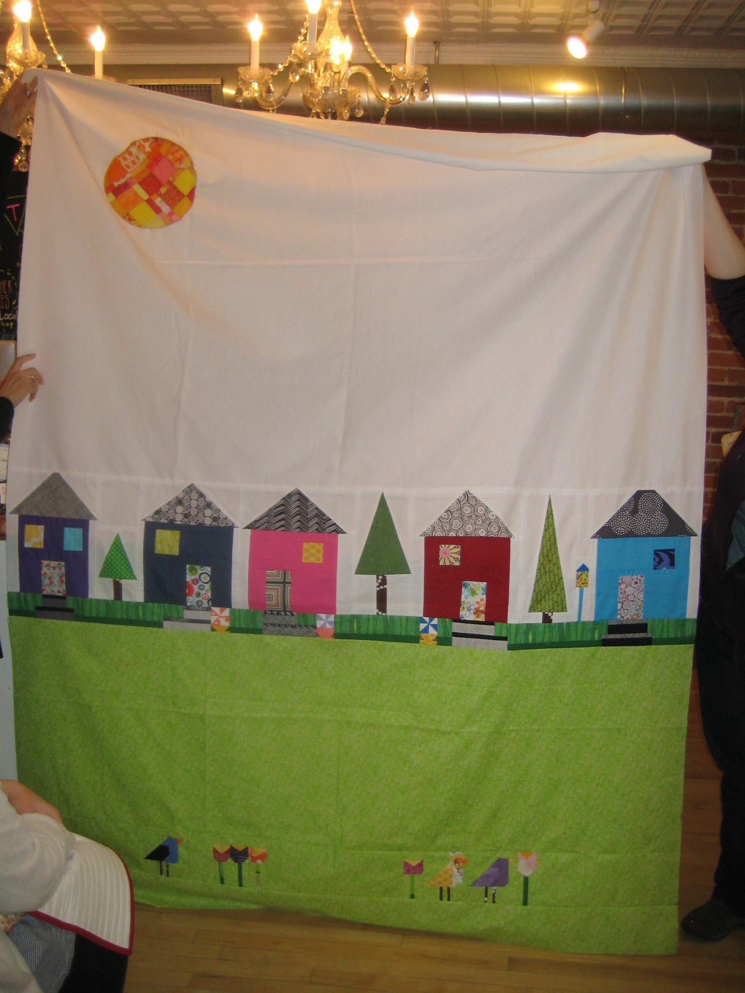 Improv houses with paper-pieced brids. A quilt for Britt's daughter.