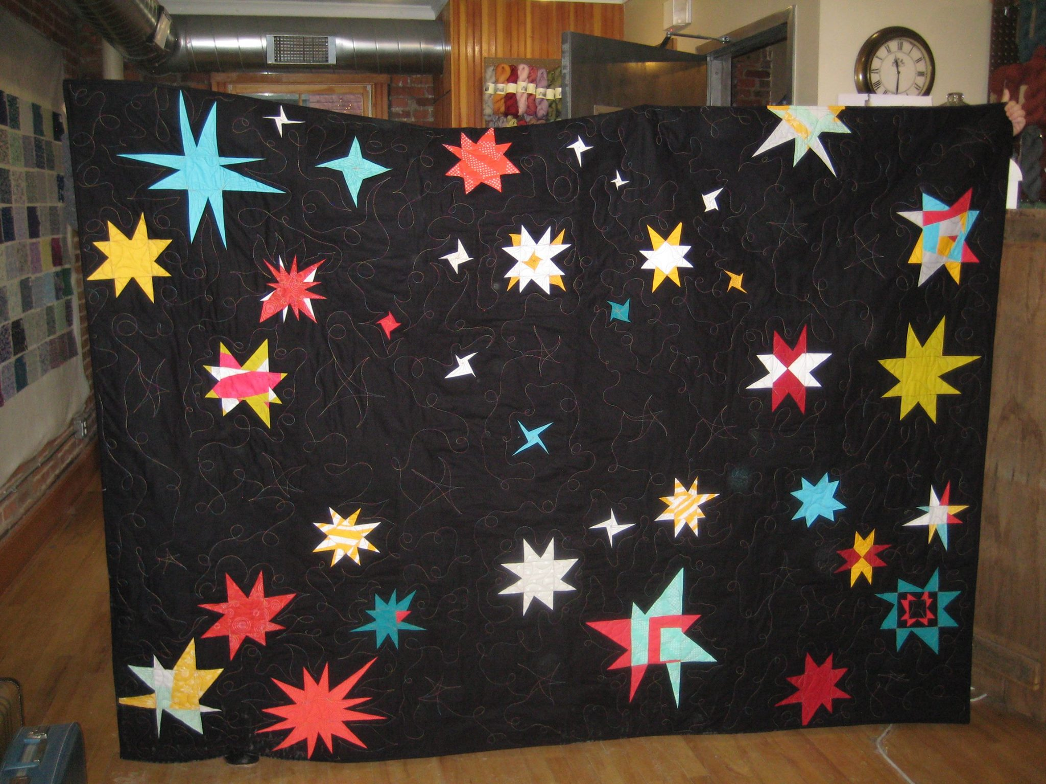 Our charity quilt with beautiful custom quilting by Marty!
