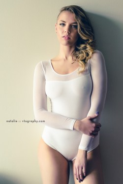 Natalie in white bodysuit