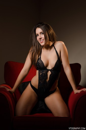 Victoria in black lace lingerie bodysuit