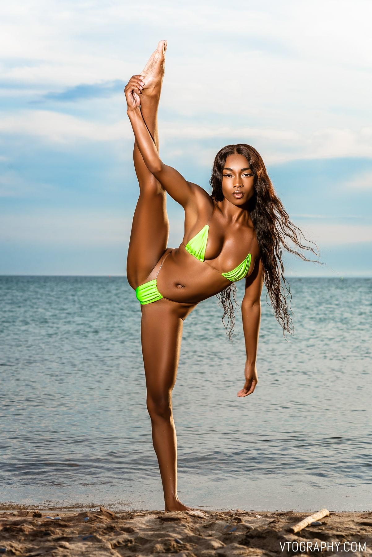 Brittany (@itssbrittbrat) — Queen Of The Splits — Black model in Fashion Nova lime green bikini