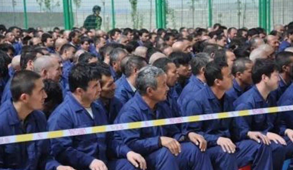 A photo taken from social media believed to be of Uyghurs and other Turkic Muslims held in a reeducation camp somewhere in Xinjiang. (Image: supplied)