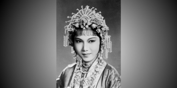 A black and white photo of Xin Fengxia dressed for a performance.