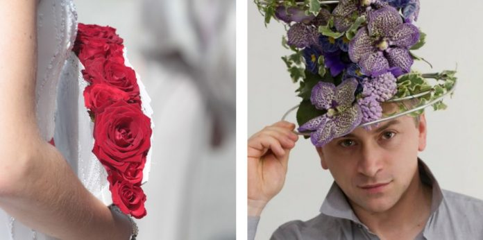 A bride holding a bouquet of red flowers arranged by Luca Nuvoli and the artist himself wearing a hat made of flowers.