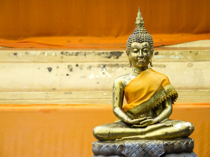 yellow buddha with a yellow robe