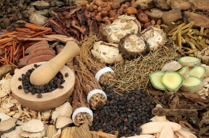 Chinese alternative herbal medicine with a collection of herbs & spices.