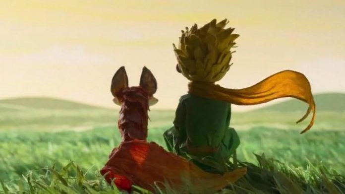 little prince sits next to fox
