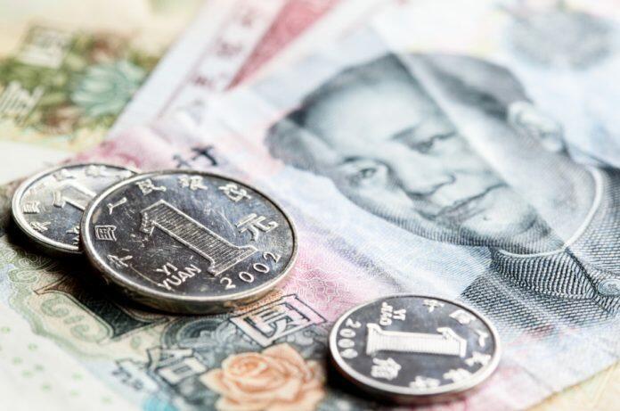 Chinese yuan renminbi banknotes and coins close-up.