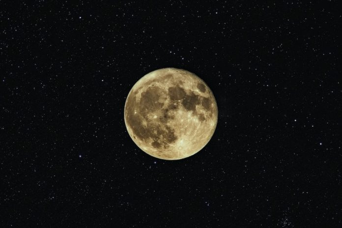 full moon with stars in background