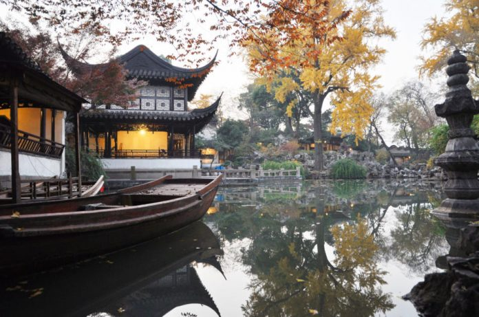 Chinese ancient garden with pond in autumn, Suzhou, China.