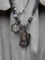 Two classic necklaces - a miniature painted portrait and a carnet de bal