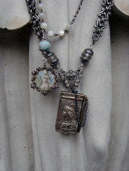 Two classic necklaces - a miniature painted portrait and a carnet de bal