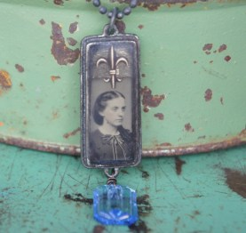 Necklace with tintype photo set in bezel under resin