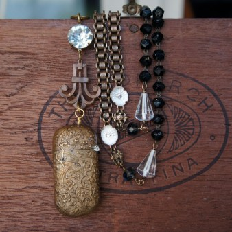 Necklace made with antique match case focal