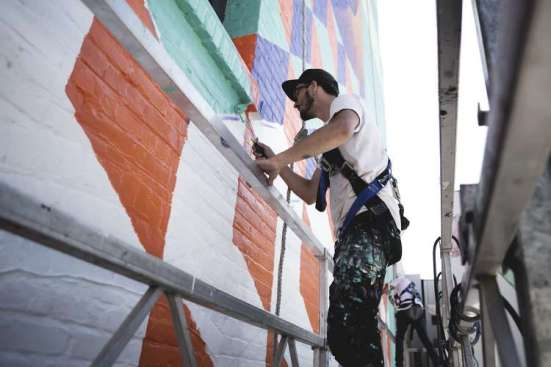 Michael working on his mural for Forest Of The Trees 2015 (also the feature image above) - located in Portland, Oregon