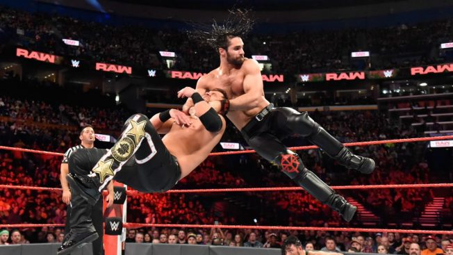 Seth Rollins takes out Curtis Axel