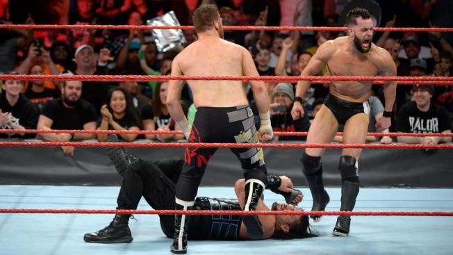Sami Zayn and Finn Balor gang up on Roman Reigns