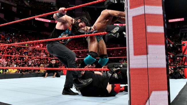 Elias and Jinder Mahal stomp on Seth Rollins