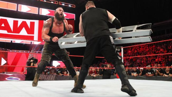 Kevin Owens hits Braun Strowman with a ladder
