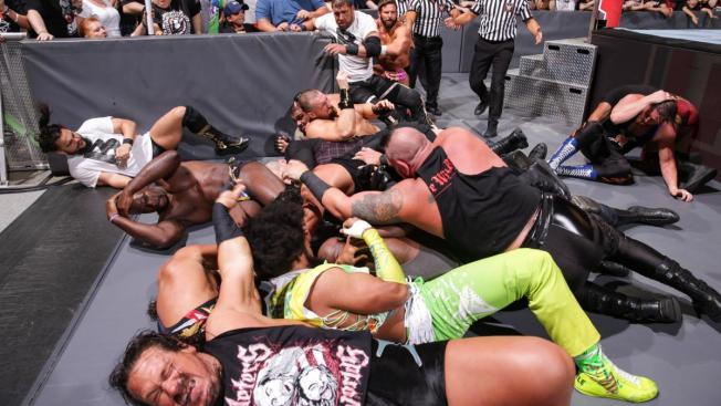 The aftermatch of ROman Reigns dive over the top rope, superstars everywhere