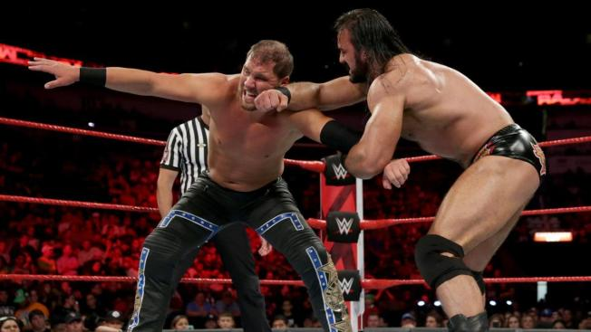 Drew McIntyre prevents Curtis Axel reaching for a tag