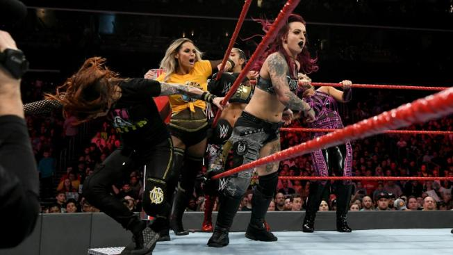 Ruby Riott knocks Lita off the apron during the 10 woman tag
