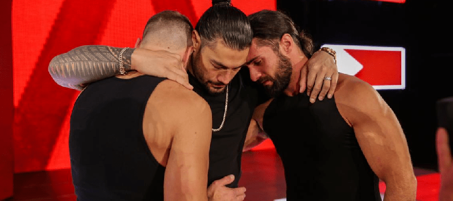 Dean Ambrose and Seth Rollins embrace Roman Reigns after his leukemia announcement